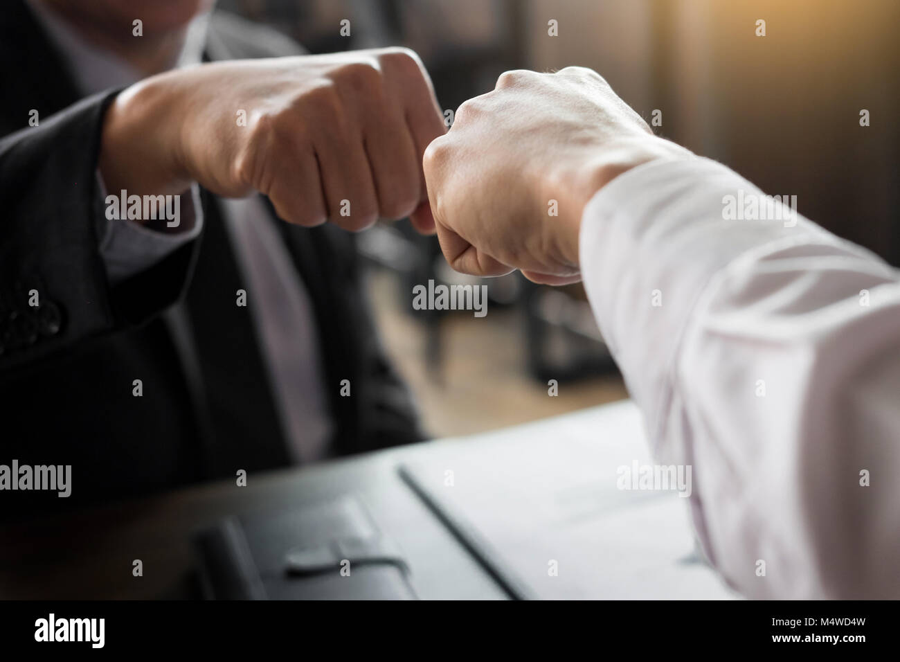 Business partners giving fist bump to commitment greeting start up business partners giving fist bump to commitment greeting start up new project or complete mission successful deal together with strong teamwork sta m4hsunfo