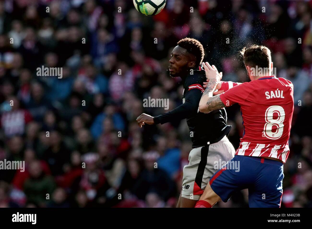 Madrid, Spain. 18th Feb, 2018. Atletico Madrid's Saul Niguez (R) vies with Inaki Williams of Athletic Bilbao - Stock Image
