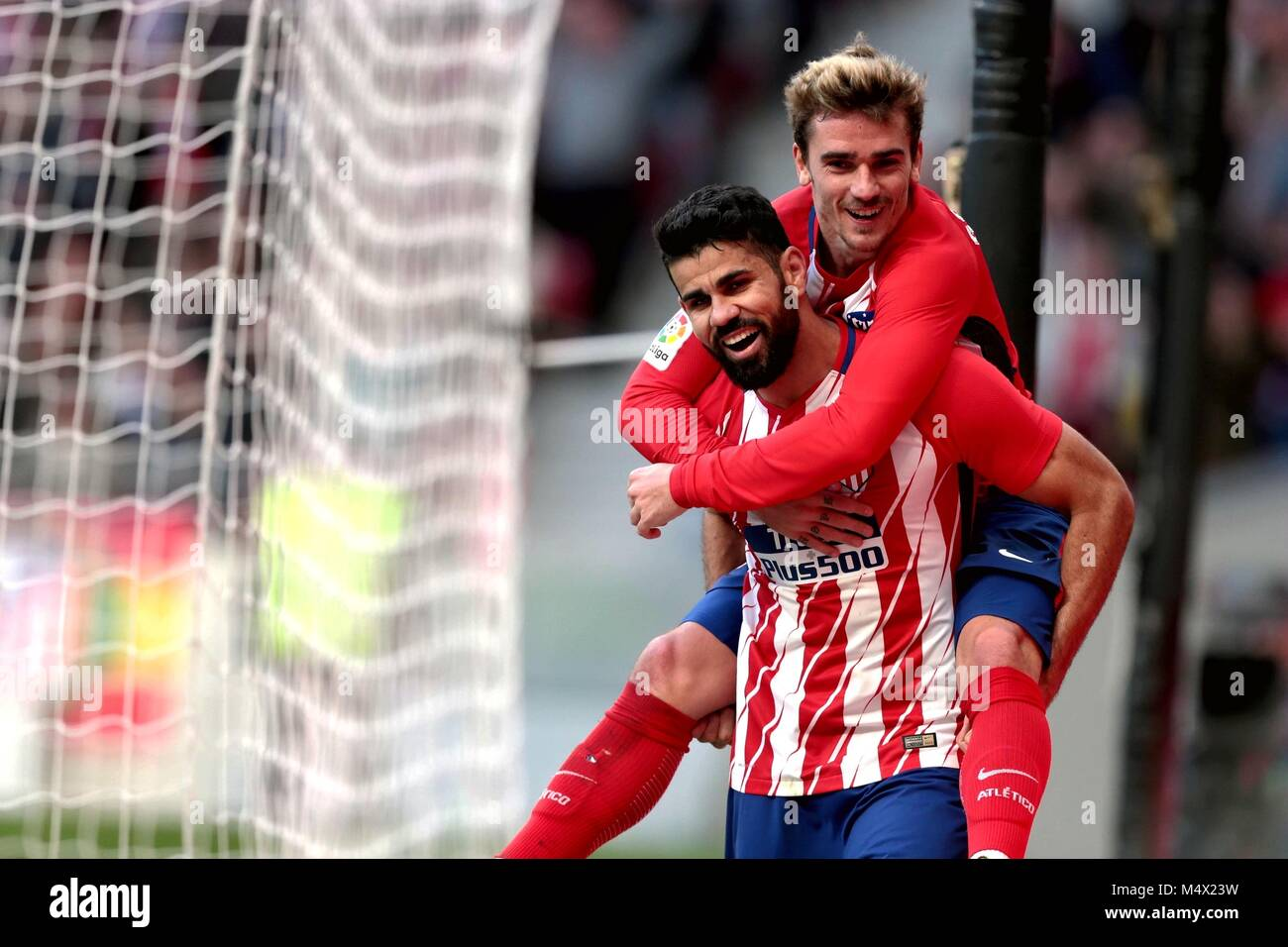 Madrid, Spain. 18th Feb, 2018. Atletico Madrid's Diego Costa (Bottom) celebrates with his teammate Antoine Griezmann - Stock Image
