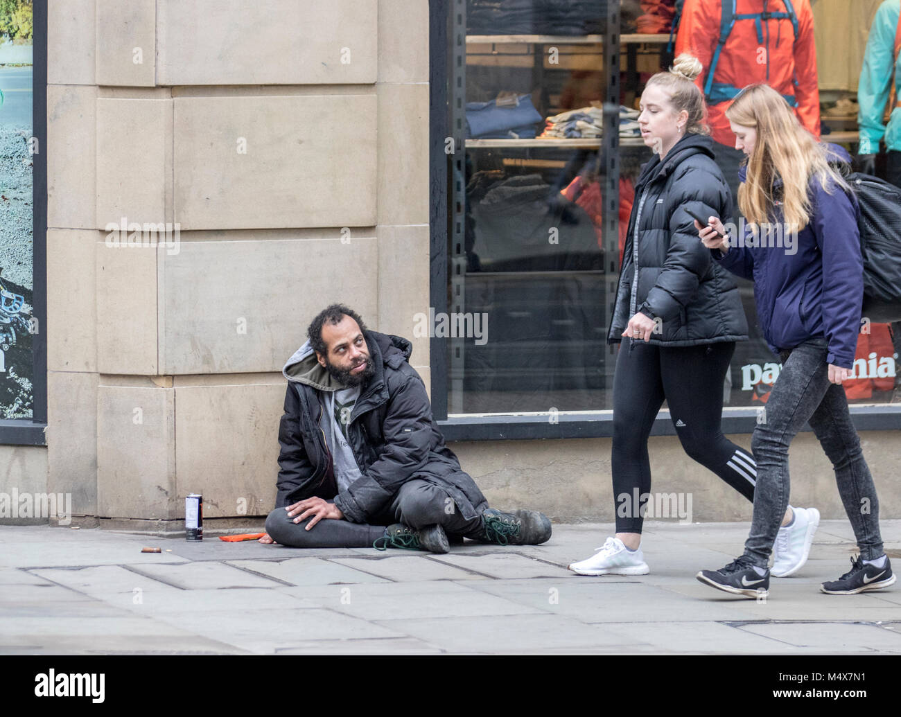 homeless homelessness sleeping rough beg beggar begging hungry cold winter sad donation money tramp hobo poor poverty - Stock Image