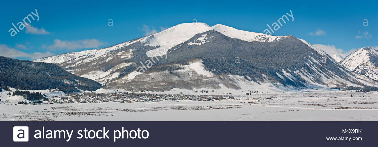 Mount Emmons towers over the town of Crested Butte, Colorado on a perfect but cold winter day. - Stock Image