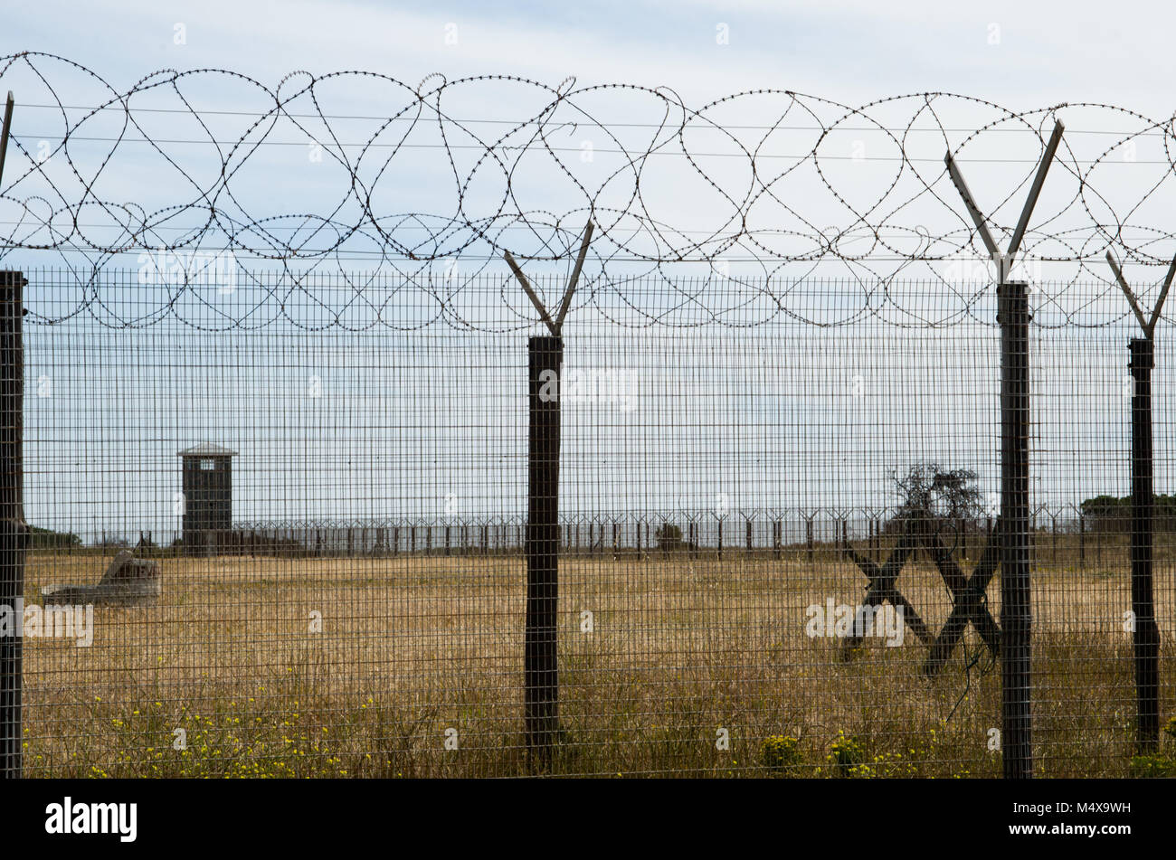Barbed wire fence at Robben Island near Cape Town Stock Photo