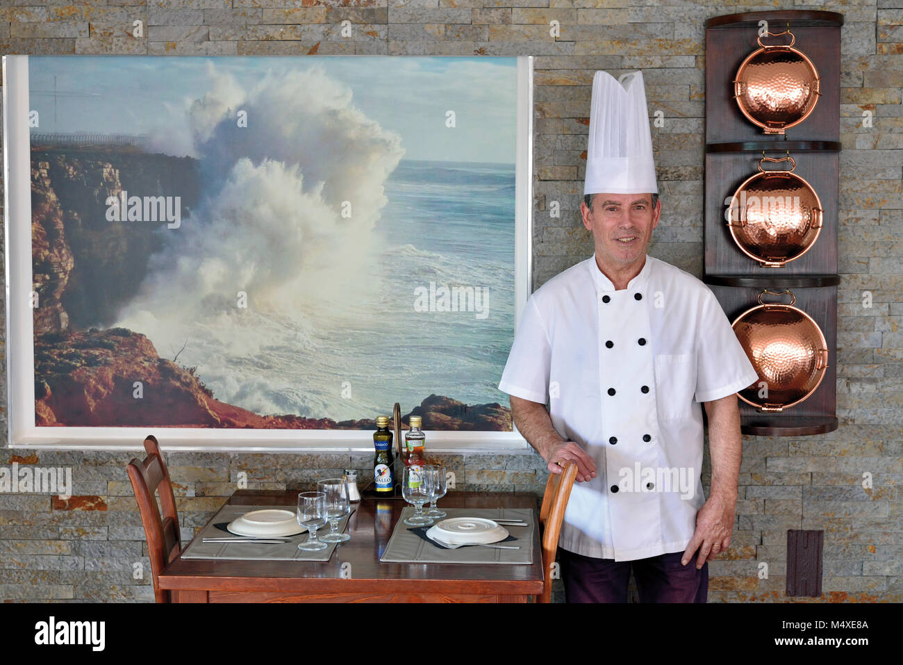 Chef Gilberto Furtado in cooking outfit in his restaurant 'Gigi' in Sagres - Stock Image
