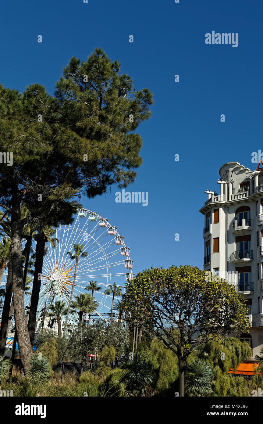 Ferris wheel in the city of Nice, french riviera, against a deep blue sky. (Winter time) - Stock Image