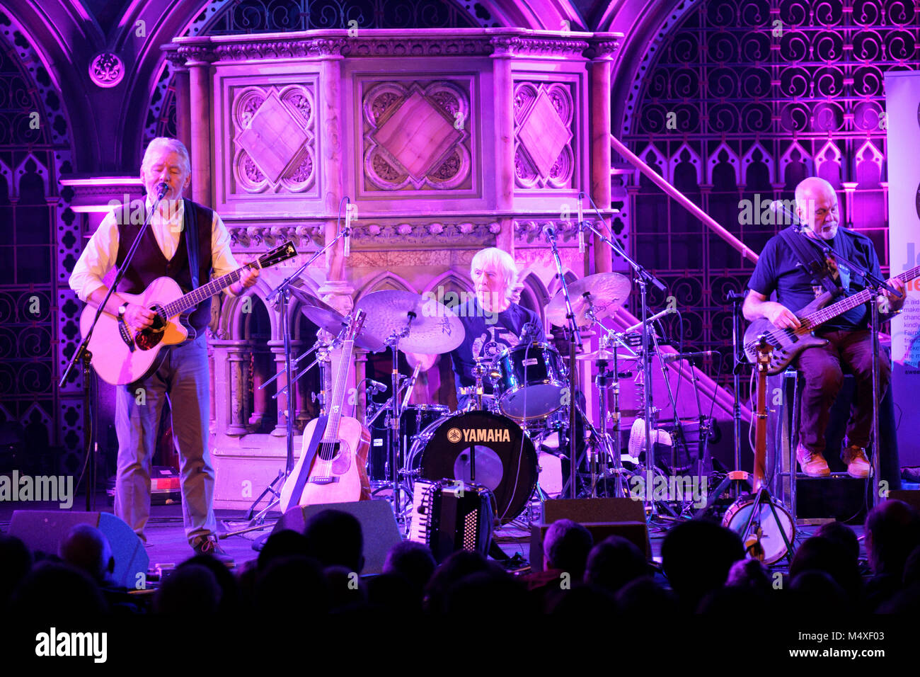 Simon Nicol, Gerry Conway, Dave Pegg of Fairport Convention playing at the Union Chapel, Islington, London, February - Stock Image