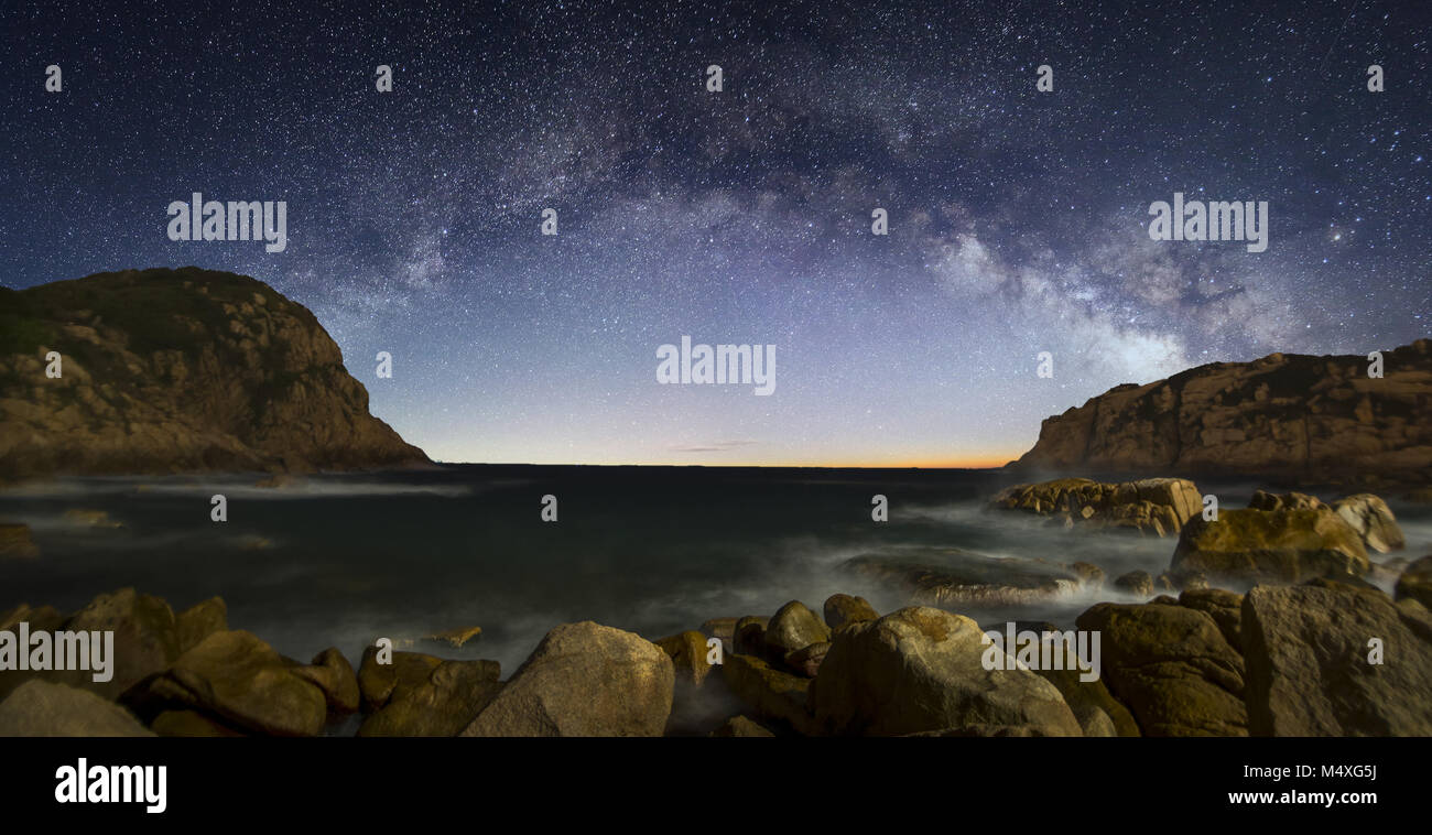 Curved Milky Way over the sea Stock Photo