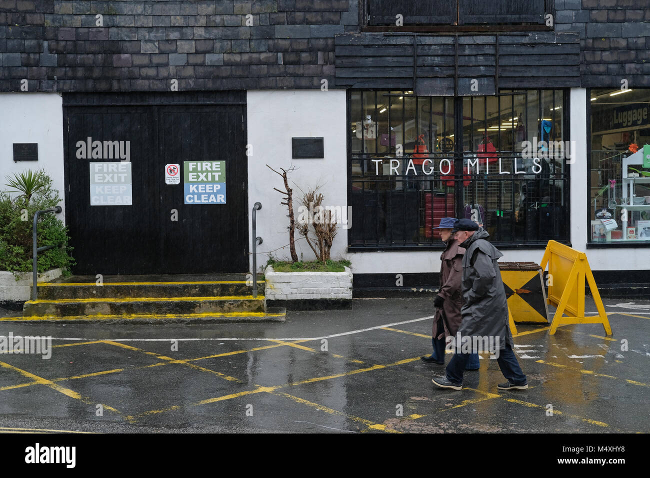People walking past Trago Mills in Falmouth, Cornwall. - Stock Image