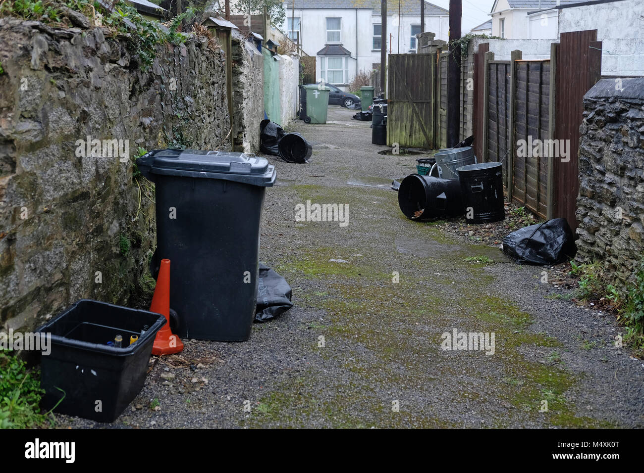 Rubbish bins on a backstreet in Falmouth, Cornwall. - Stock Image