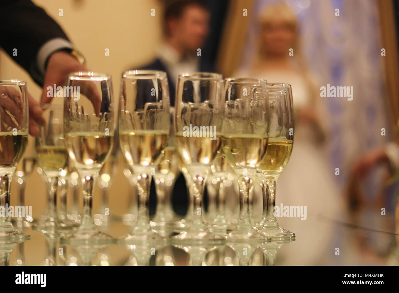 Wedding Accessories. Bridal bouquet and champagne glasses. - Stock Image