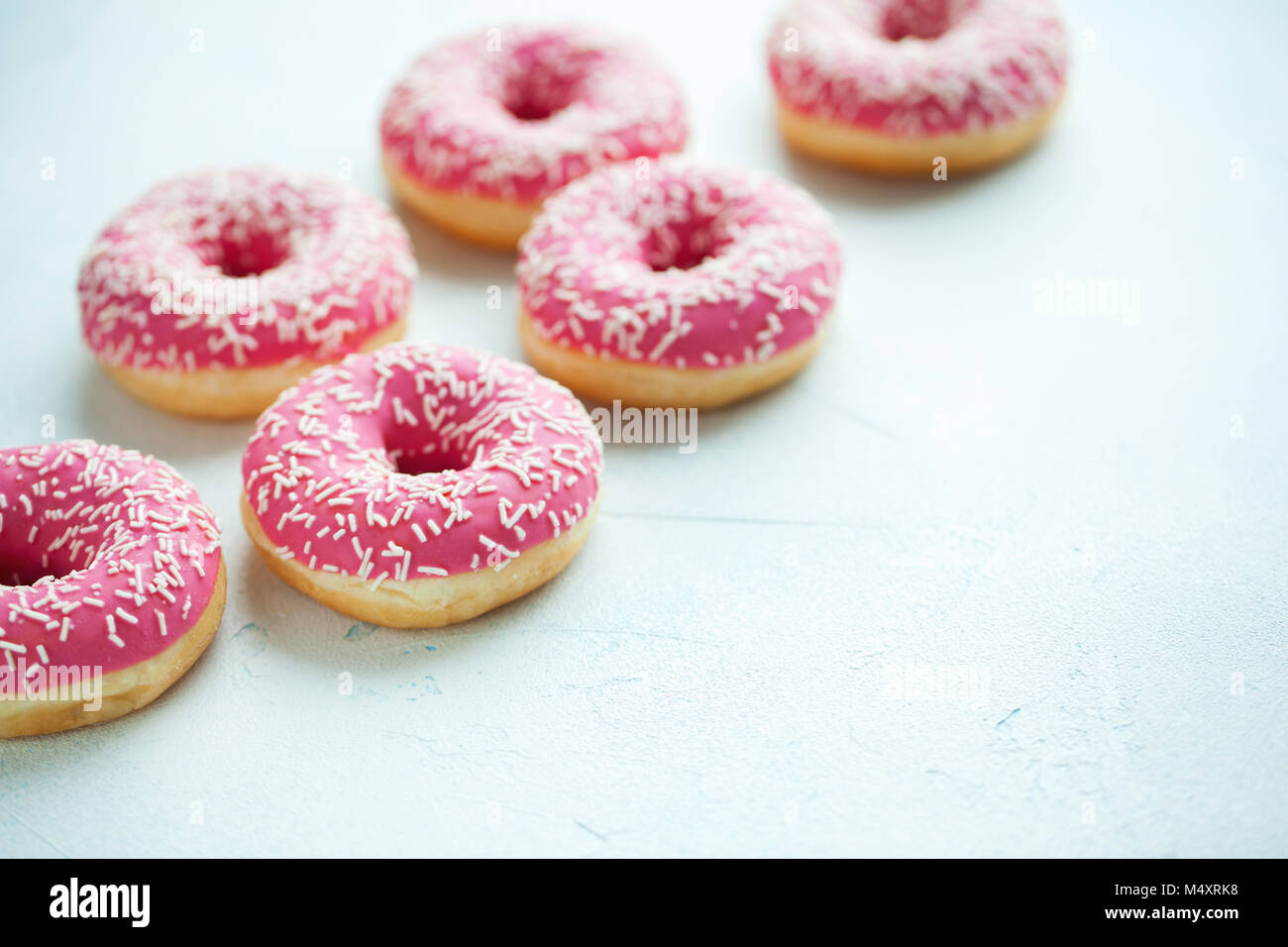 Donut. Sweet icing sugar food. Dessert colorful snack.Treat from delicious pastry breakfast. Bakery cake. Doughnut - Stock Image