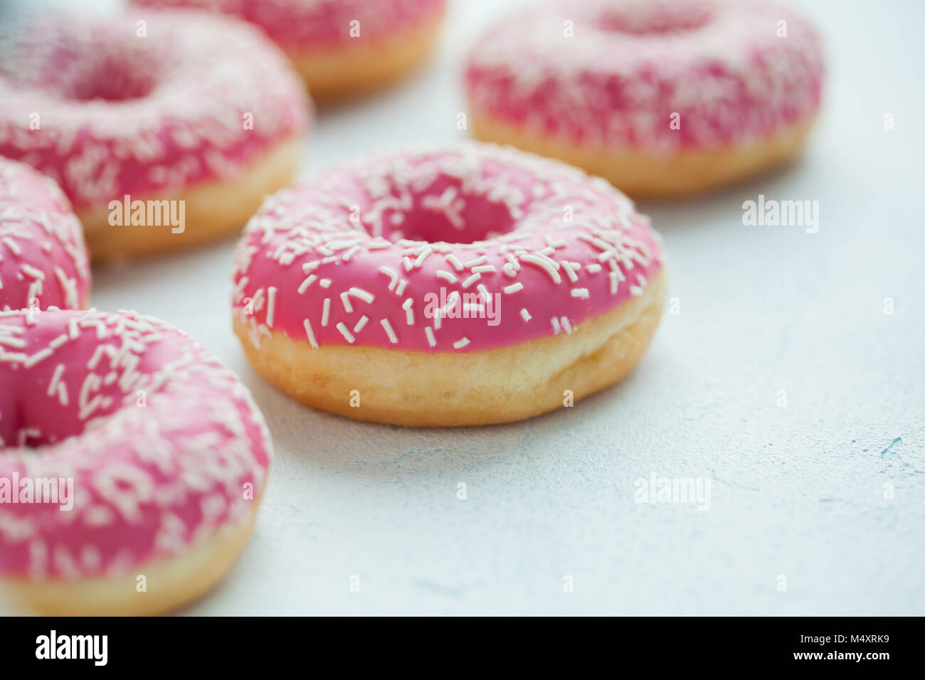 Donut. Sweet icing sugar food. Dessert colorful snack. Glazed sprinkles. Treat from delicious pastry breakfast. - Stock Image