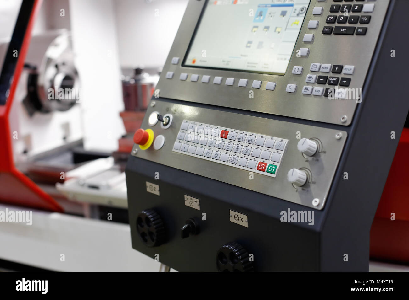 Control panel of the CNC machining center. Selective focus. - Stock Image