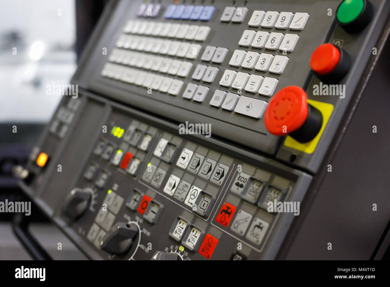 Control panel of the modern CNC machine. Selective focus. - Stock Image