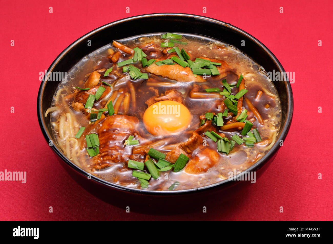 Dandan noodles with raw egg - Stock Image