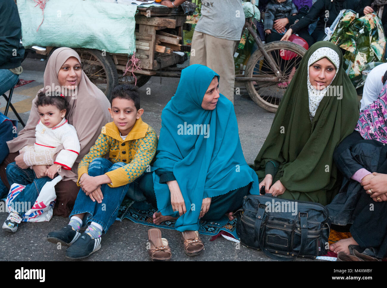 Egyptian Muslim families attend the Eid el Adha festival in Mohandiseen, Cairo - Stock Image