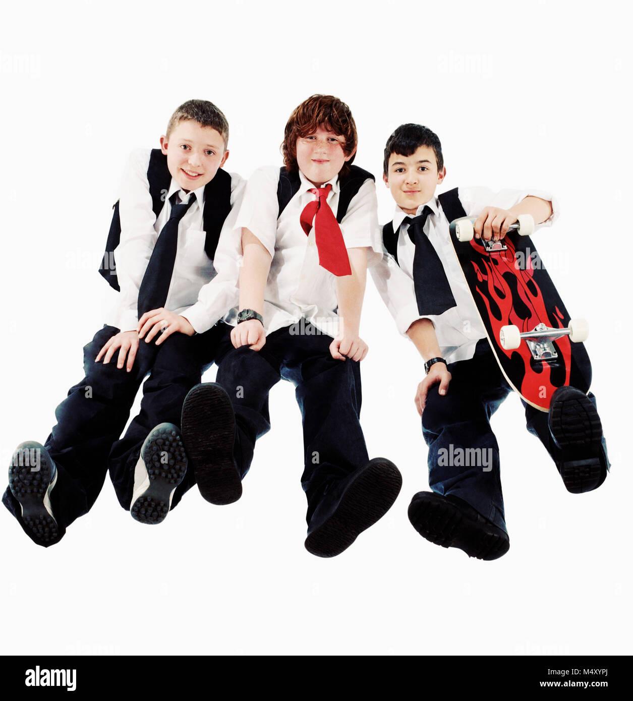 Three secondary schoolboys - Stock Image