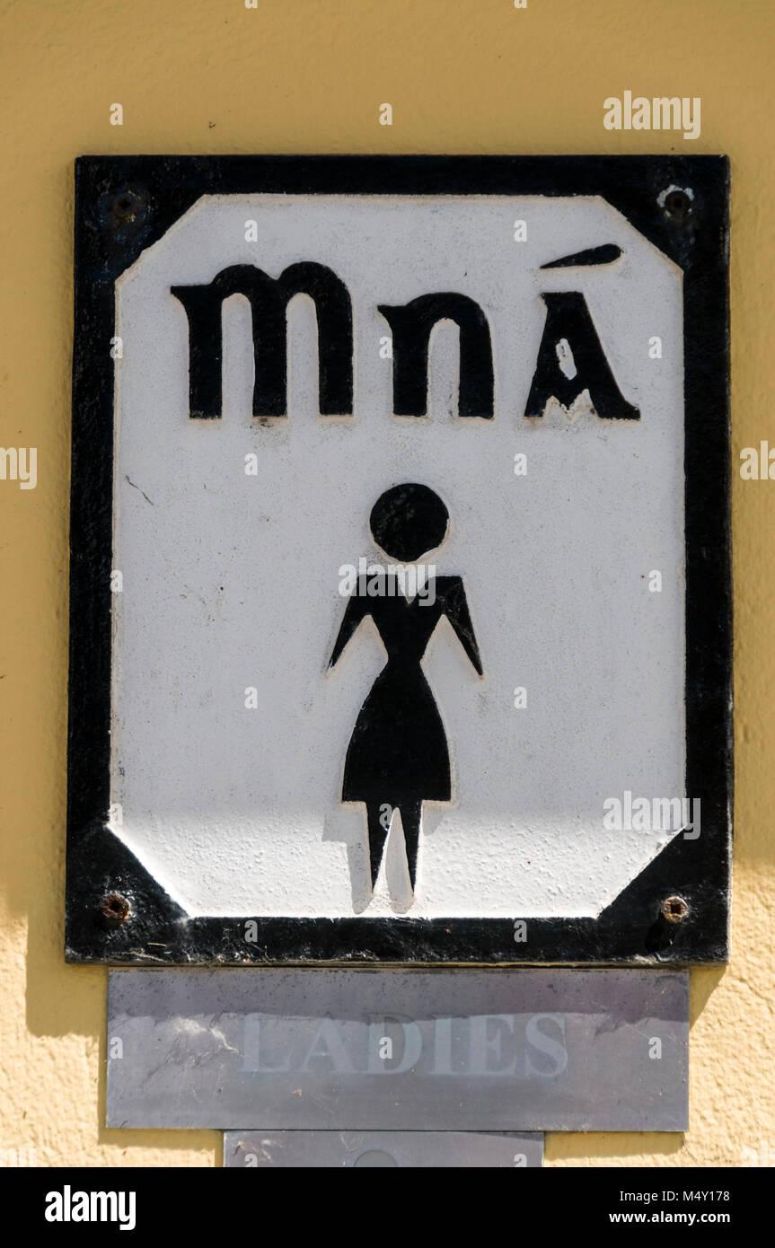 A ladies public toilets sign, Mna, in Irish Gaelic language in  Eyeries  village on the Beara Peninsula. Southern - Stock Image