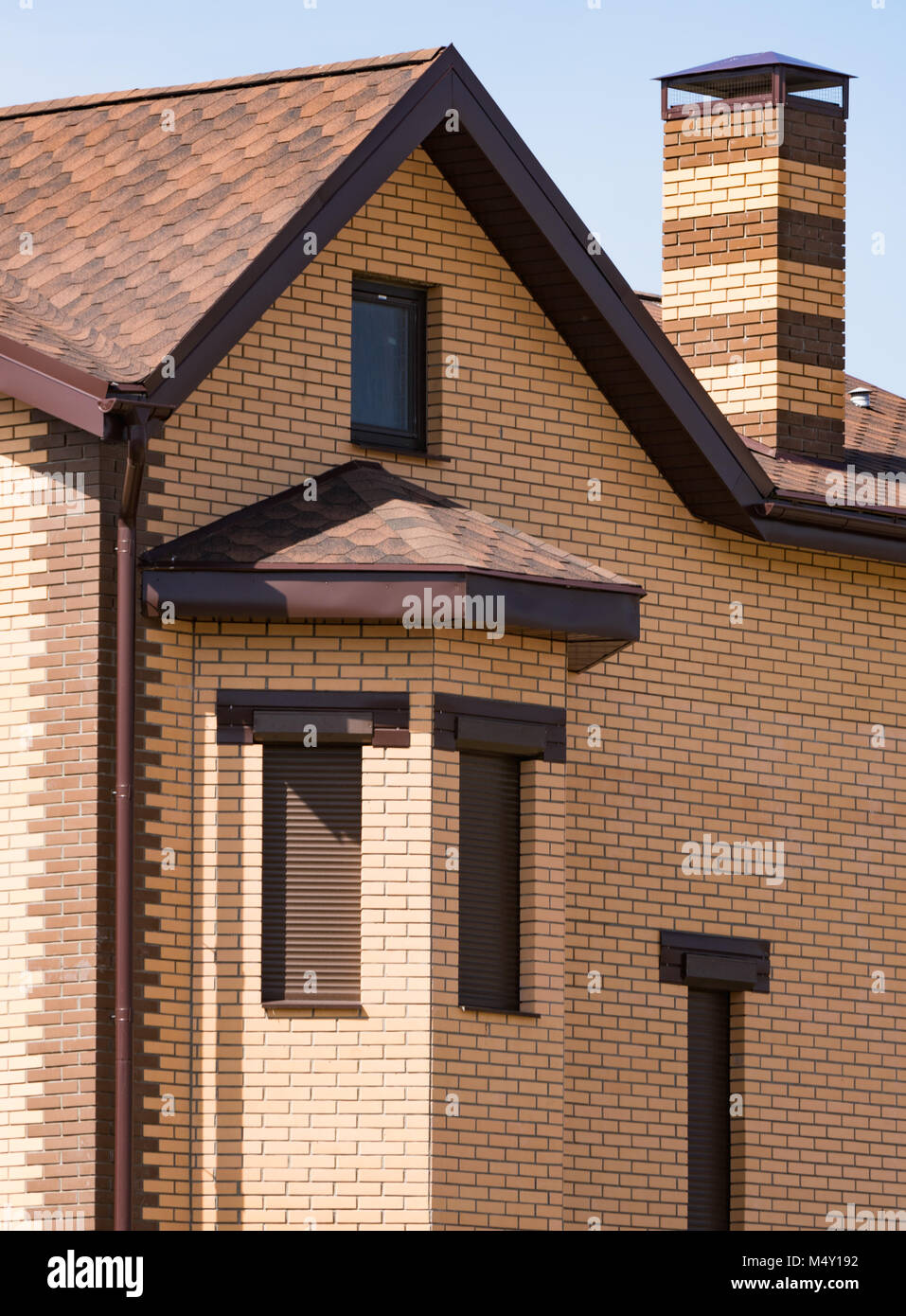 house with a gable roof window - Stock Image