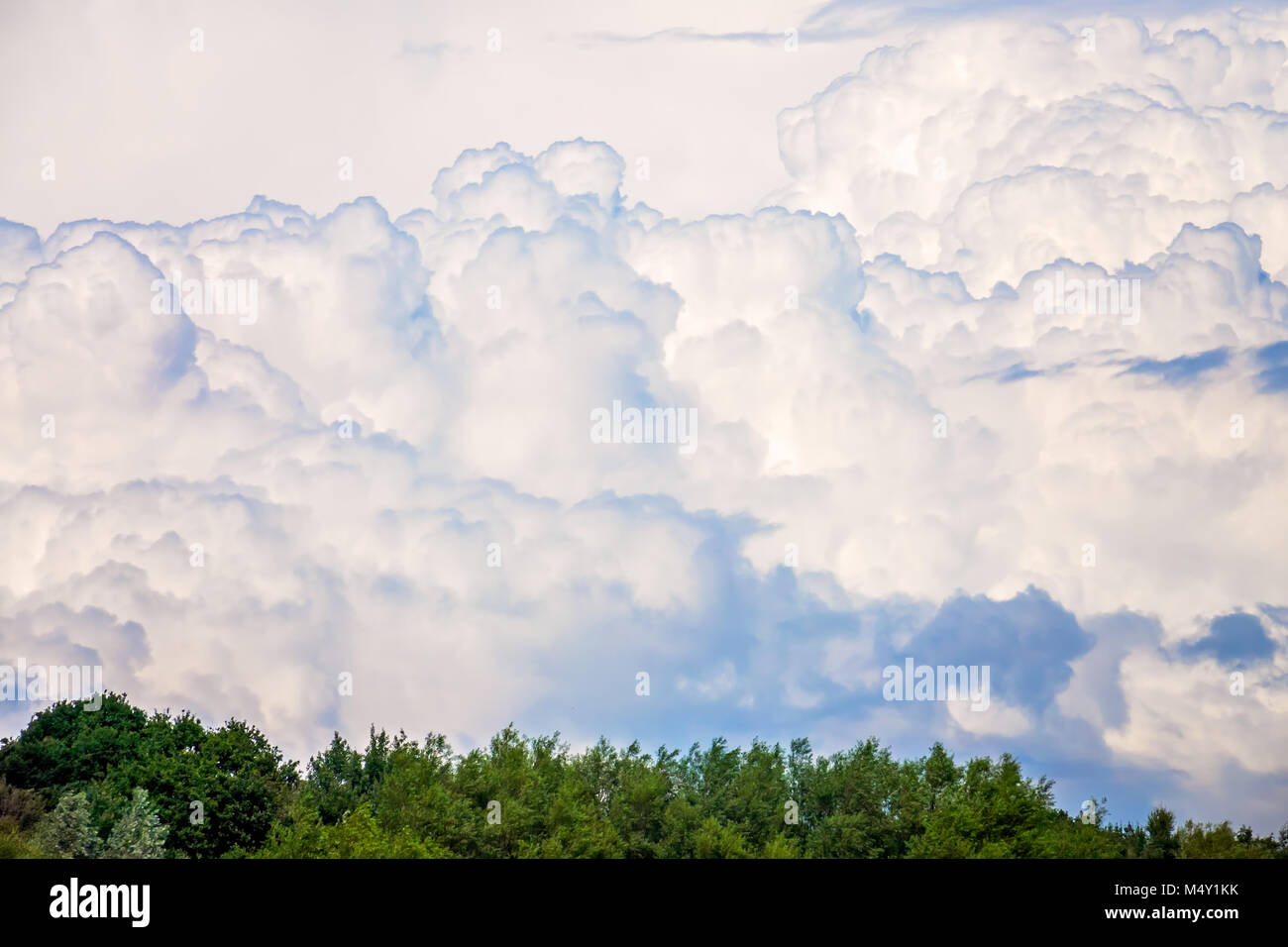 Dense fluffy clouds - Stock Image