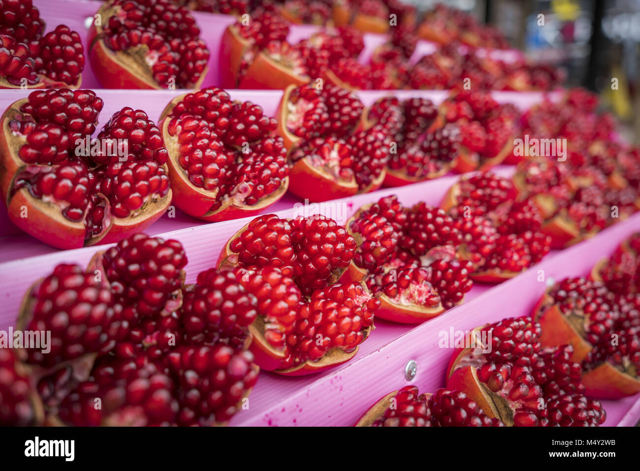 Lots of ripe pomegranate fruit, selected focus - Stock Image