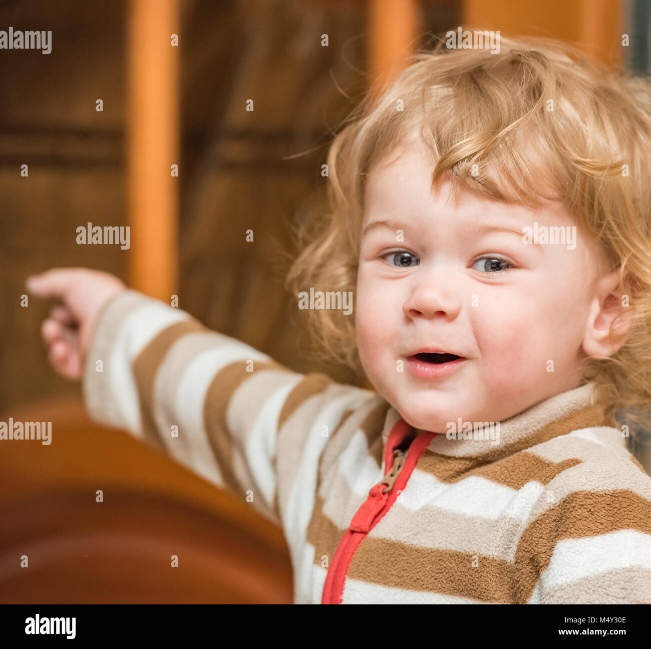Blond curly-haired child - Stock Image