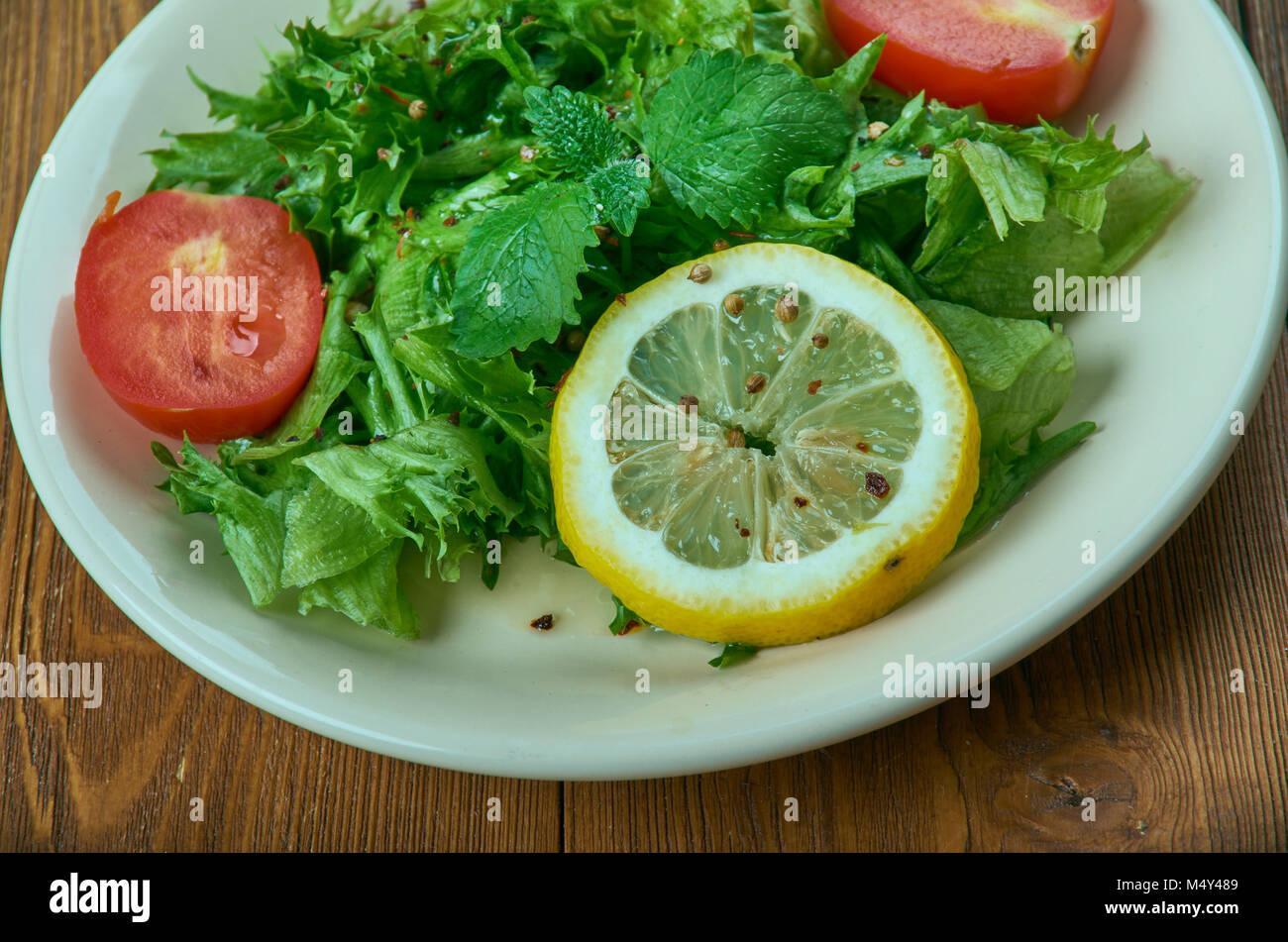 salad from leaves of wild radish - Stock Image