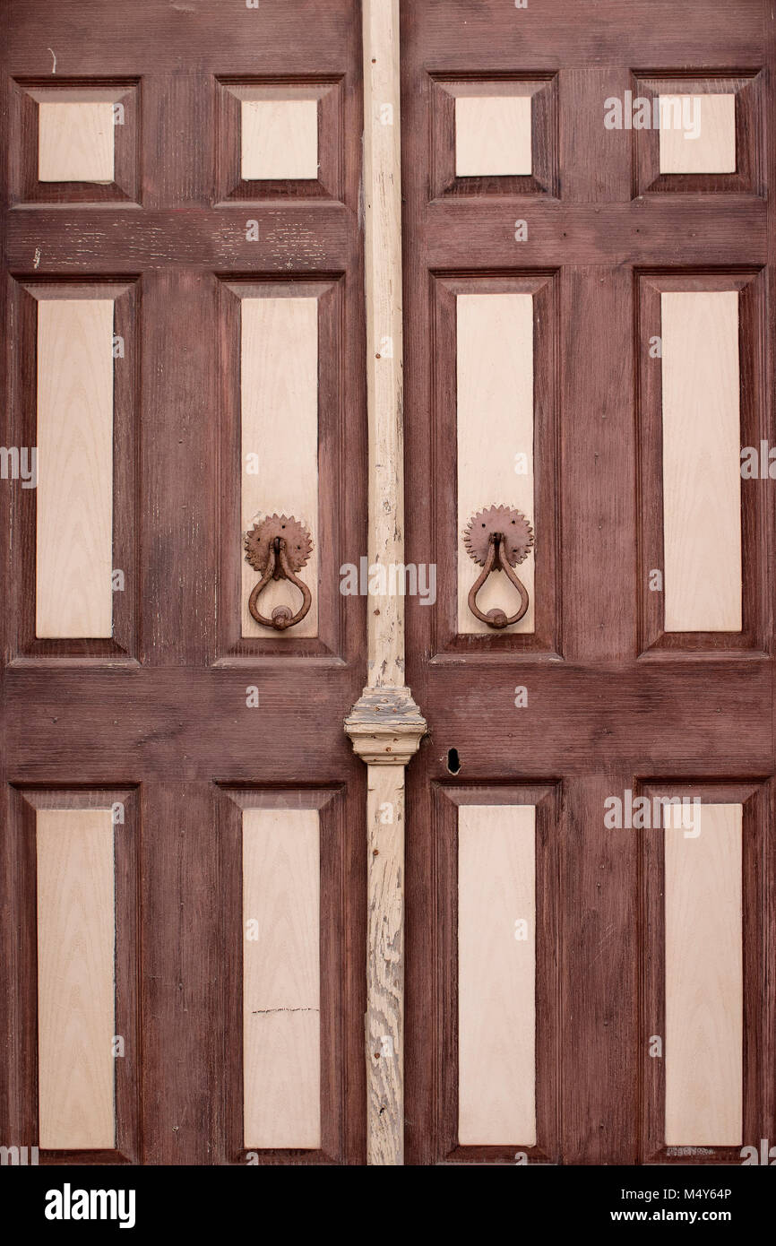 Close up view of old, wooden door in Cunda (Alibey) island. - Stock Image