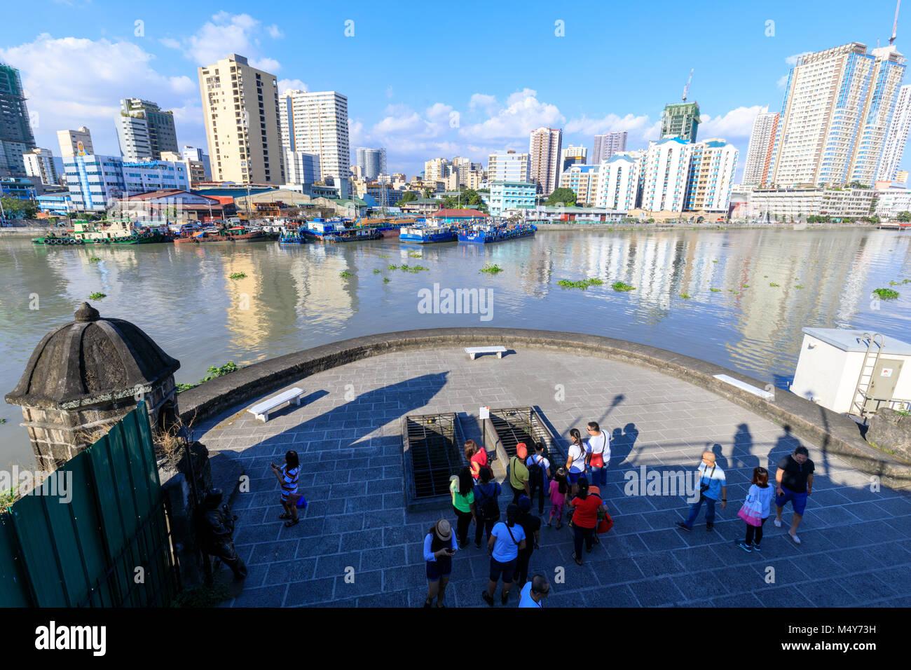 Manila, Philippines - Feb 17, 2018 : Tourist waching Manila pasig river view from Fort Santiago view deck, Intramuros, - Stock Image