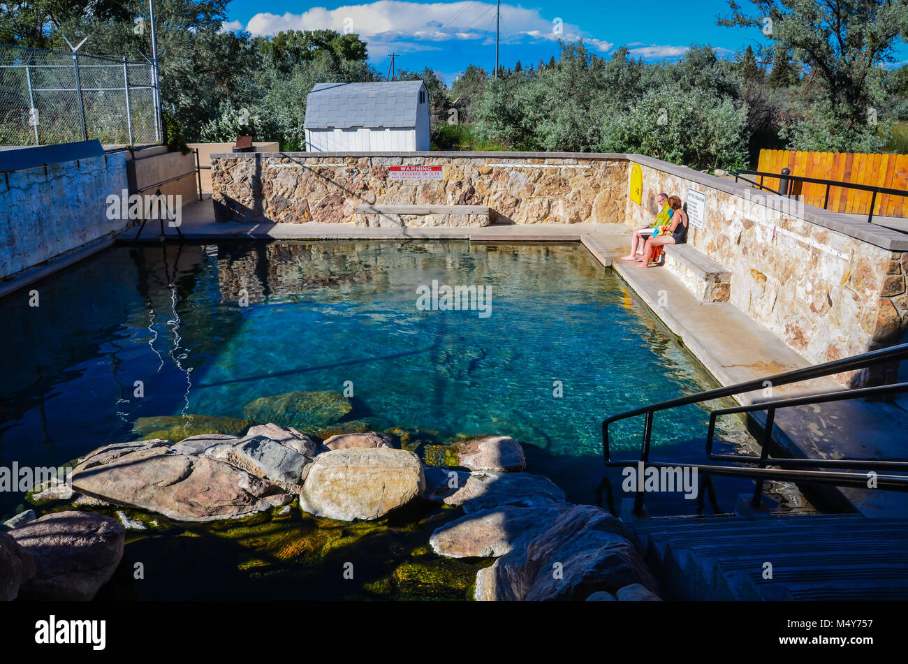 Saratoga, WY, USA. Hobo Hot Pool, a natural hot springs encased in a rock pool. - Stock Image