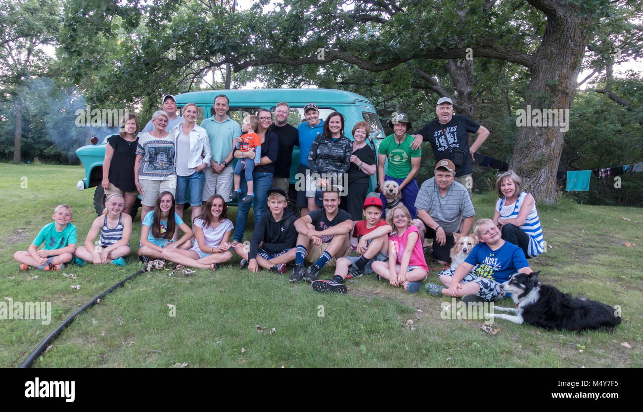 Portrait of photographer Steve Skjold's extended family of three generations at an annual picnic. Clitherall - Stock Image