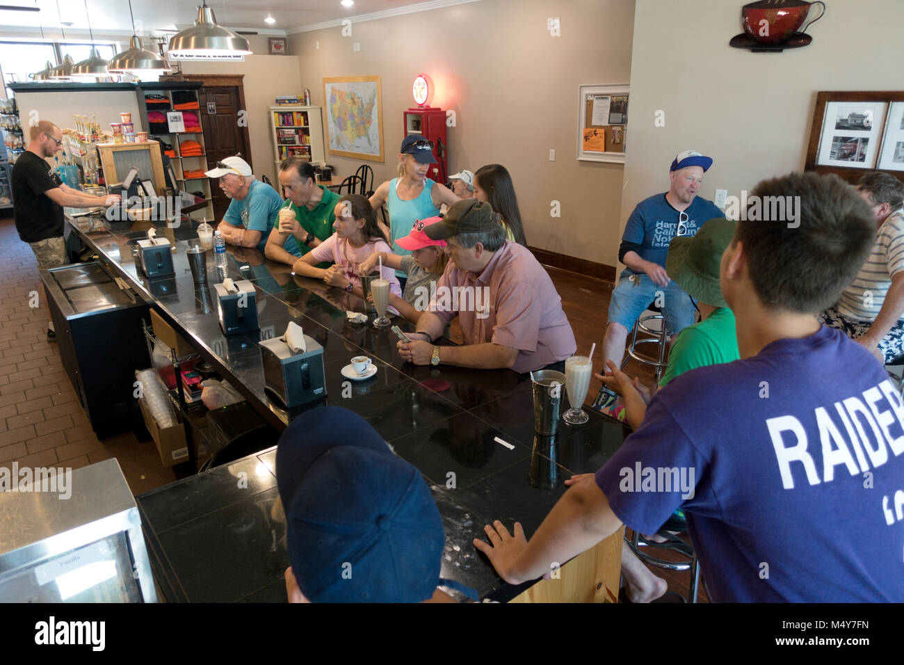 A view of people drinking malts and enjoying themselves at the Justice Two Coffeehouse & Eatery. Clitherall - Stock Image