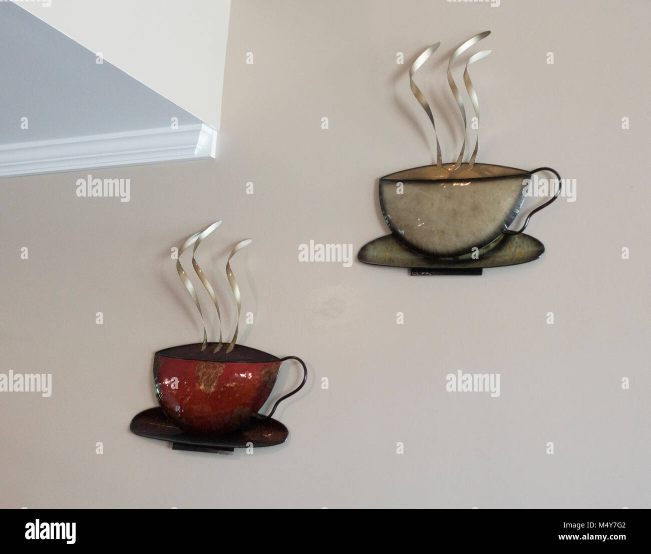 Artistic renderings of hot cups of coffee on the wall of the Justice Two Coffeehouse & Eatery. Clitherall Minnesota - Stock Image