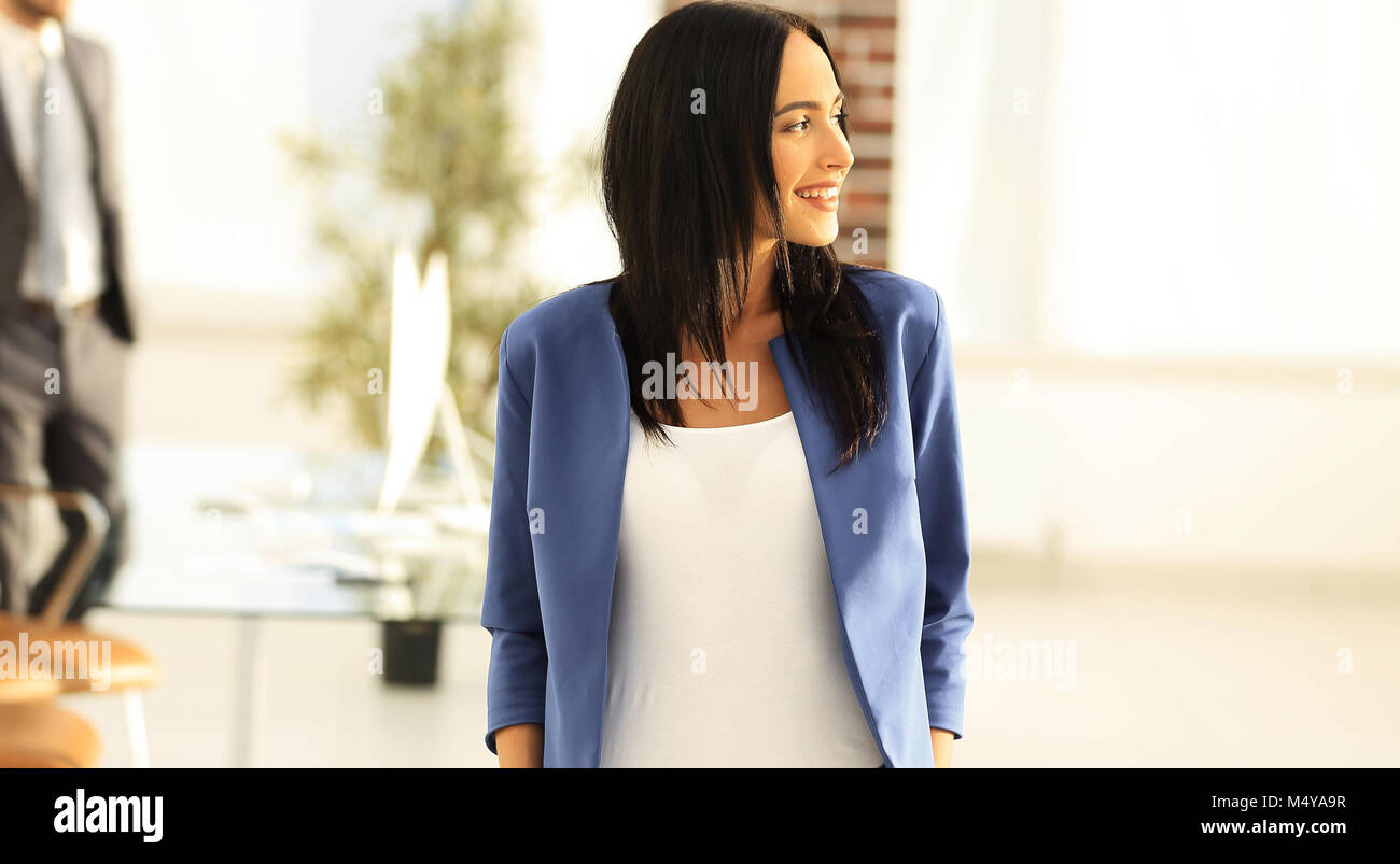 attractive female business executive in modern office - Stock Image