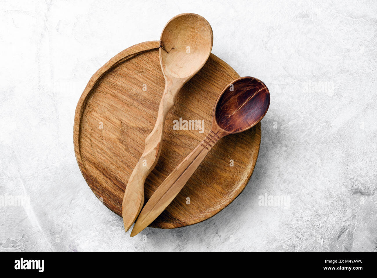Wooden kitchen accessories or kitchen props on concrete background. Top view - Stock Image