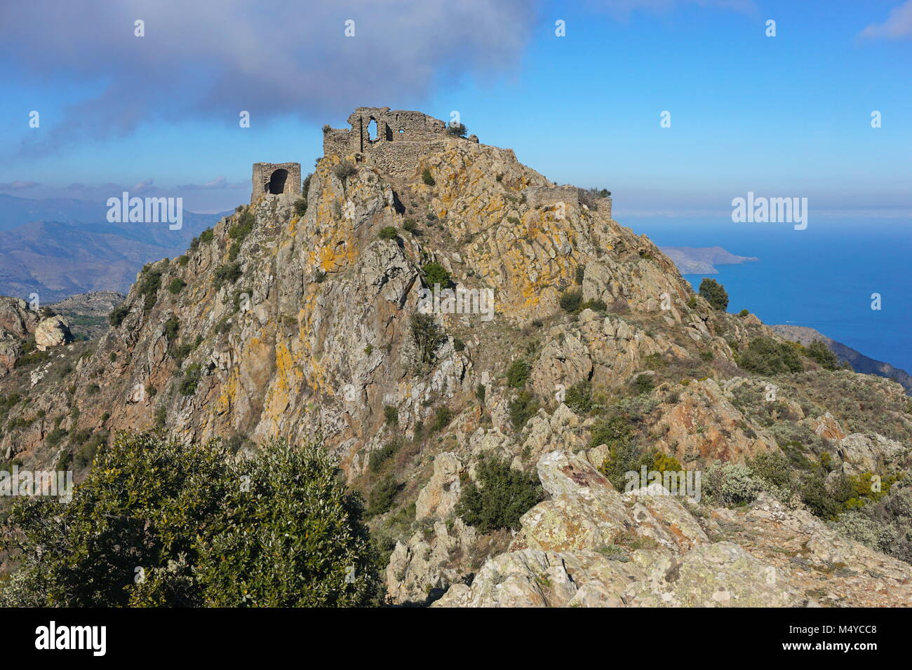 Spain the ruins of the castle de Verdera located at the top of a steep rocky spur,  Catalonia, Alt Emporda, Girona, - Stock Image