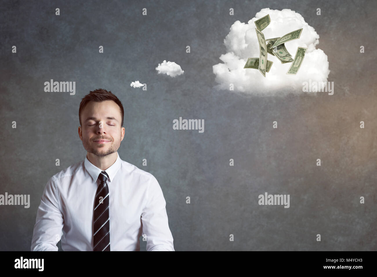 Smiling businessman thinking of money - Stock Image