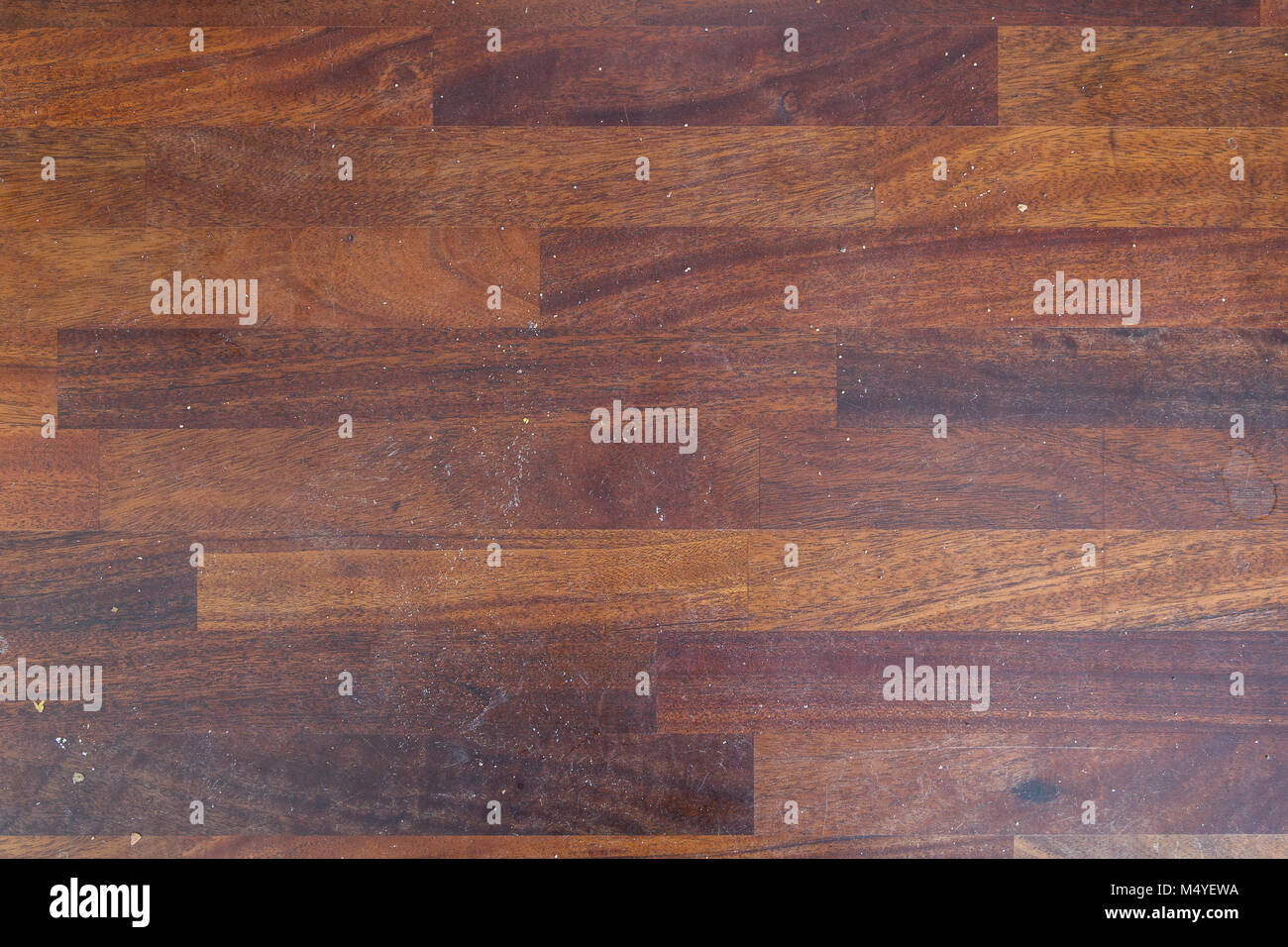 Dirty wooden kitchen counter with stains and bread crumps viewed from above. - Stock Image