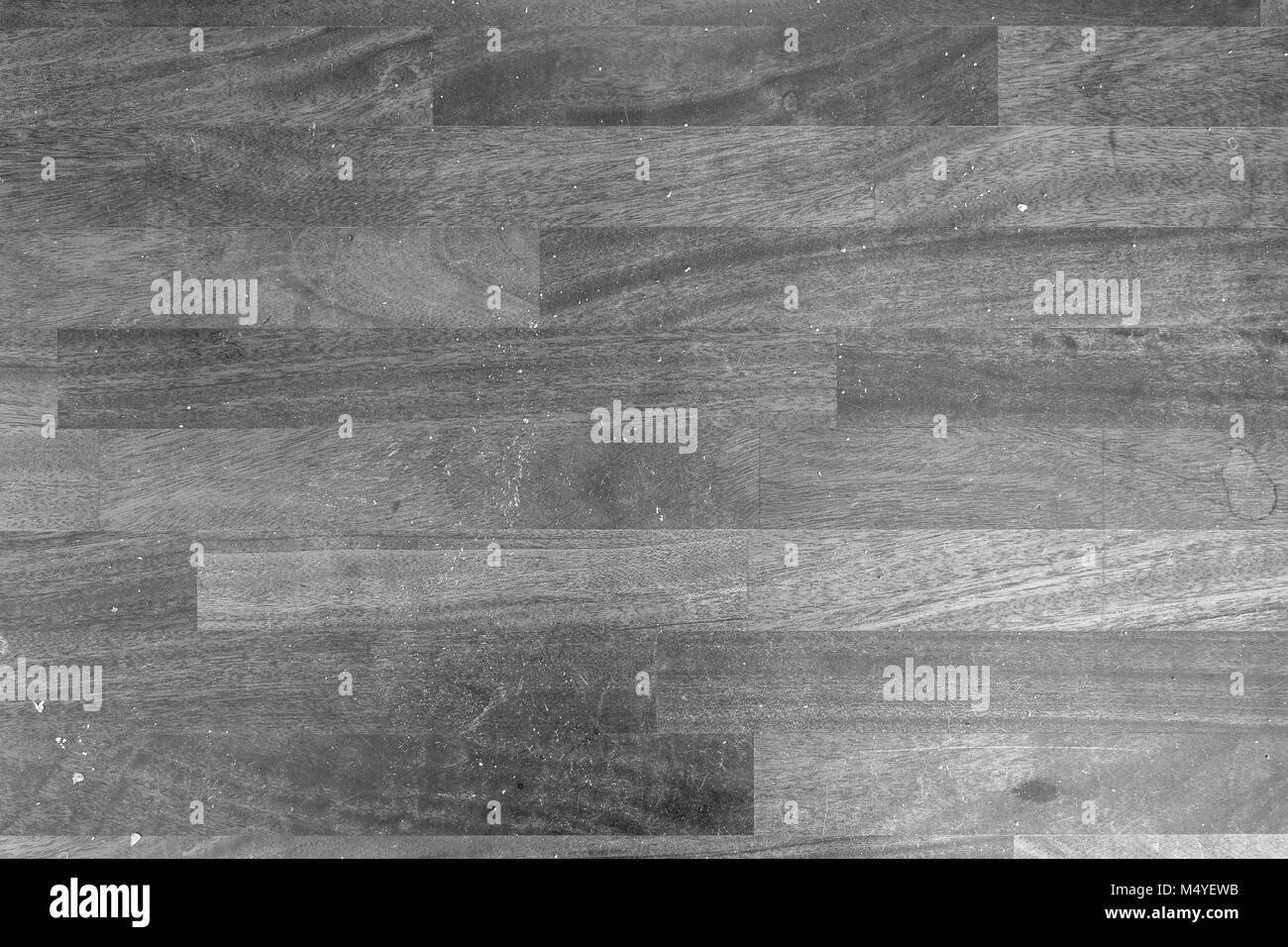 Dirty Wooden Kitchen Counter With Stains And Bread Crumps Viewed From Above  In Black And White.