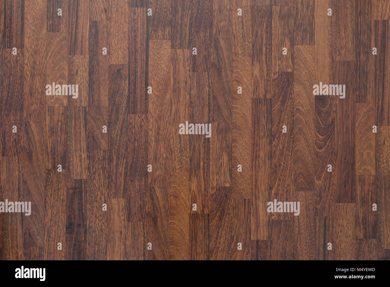 Brown wood laminate flooring texture background in house. - Stock Image