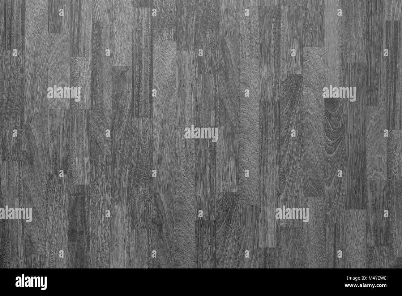 Wood laminate flooring texture background in house in black and white. - Stock Image