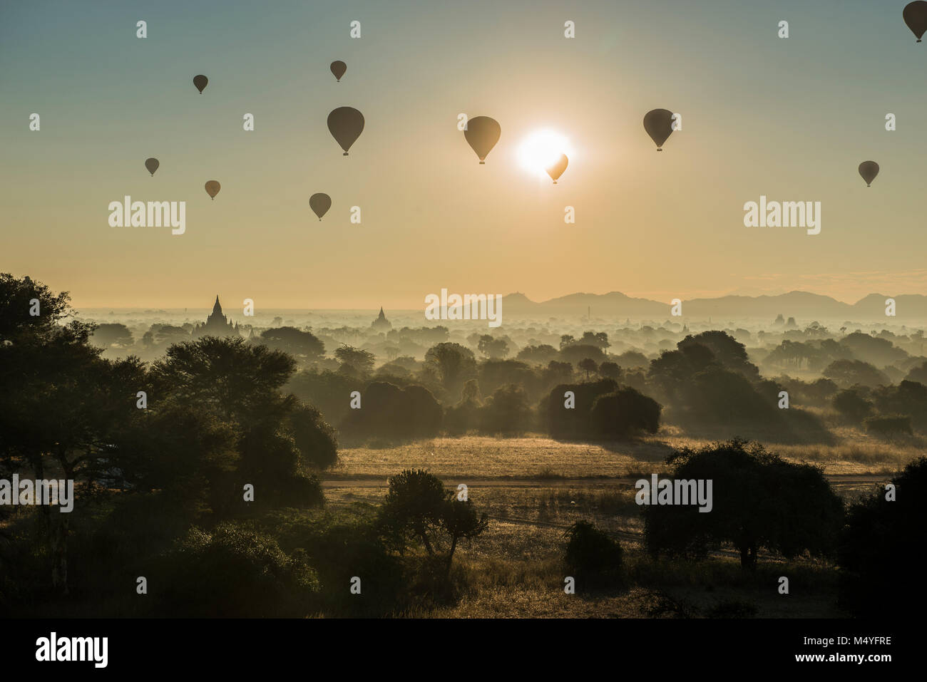 beautiful surise view of landscape in bagan myanmar wwith the clound mist and the golden temple - Stock Image