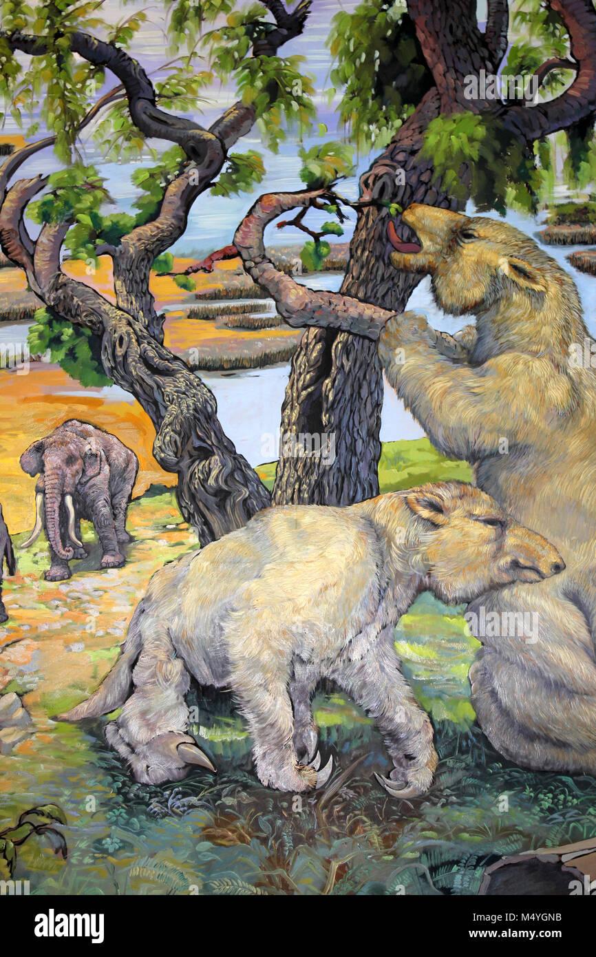 Painting of Giant Sloths Megatherium americanum and Mastodonts Cuvieronius hyodon - Stock Image