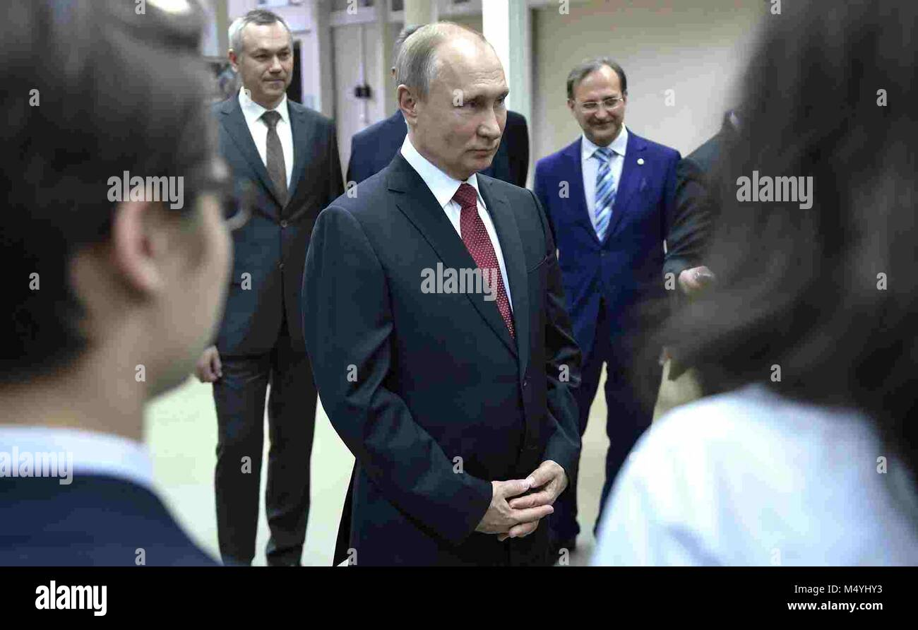 Russian President Vladimir Putin speaks to students during a tour of the Budker Institute of Nuclear Physics February Stock Photo