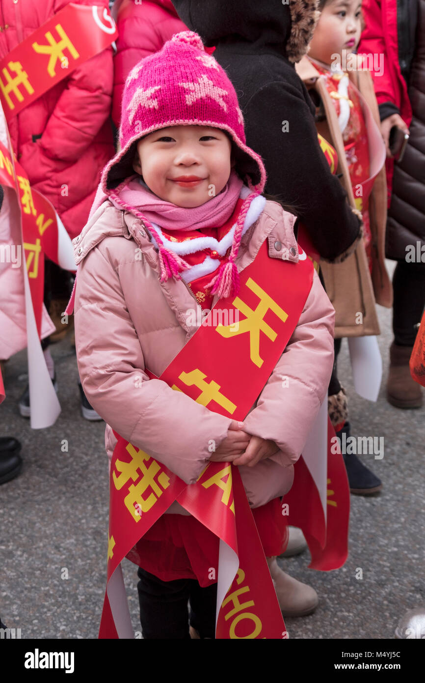 9357c1c838b A very cute young girl in a pink hat and scarf at the Chinese New Year  Parade in Flushing