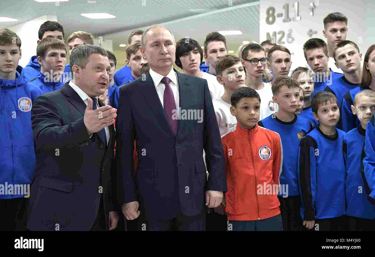 Russian President Vladimir Putin speaks with Russian Platinum Chairman Musa Bazhayev left, during a visit with the - Stock Image