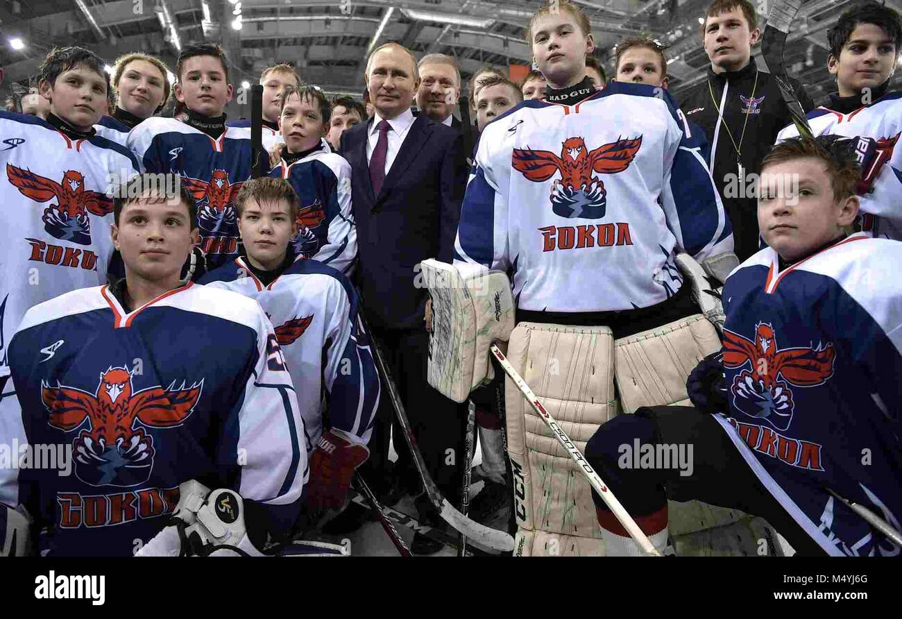Russian President Vladimir Putin poses with the youth ice hockey team Sokol at Platinum Arena Krasnoyarsk sports - Stock Image