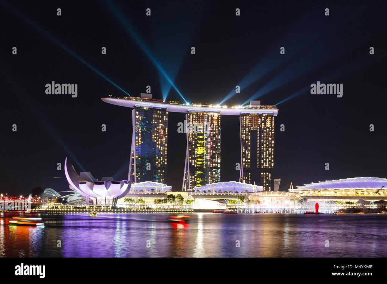 Marina Bay Sands hotel lit up at night, Singapore - Stock Image