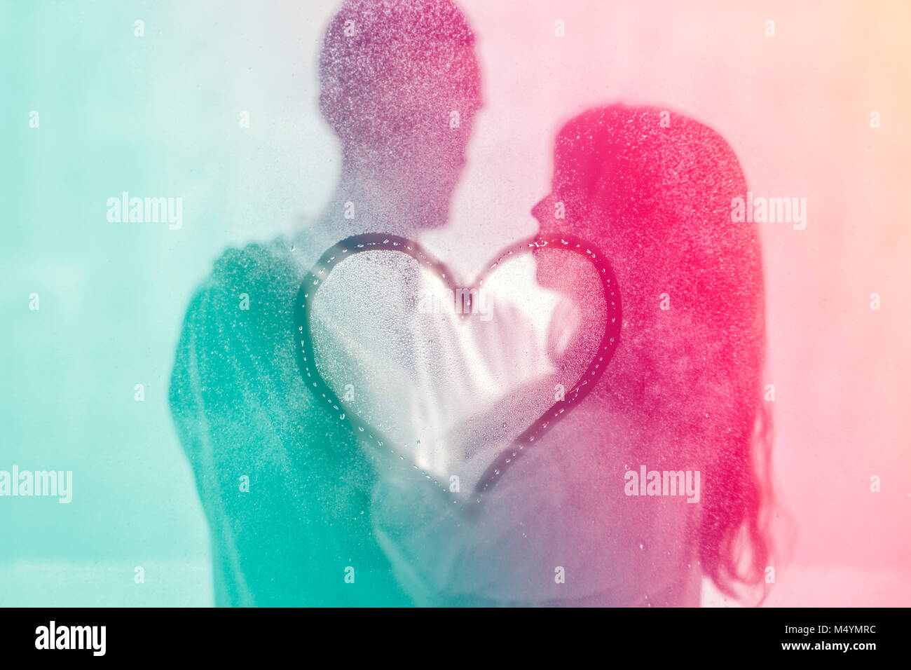 A Heart Against The Background Of A Loving Couple Young People