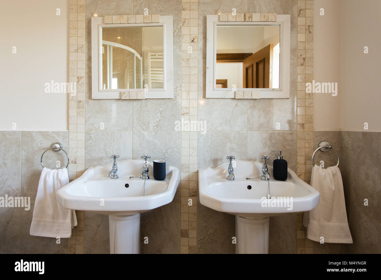 Family Bathroom With Double Basin Set Up With Two Mirrors And Two Stock Photo Alamy