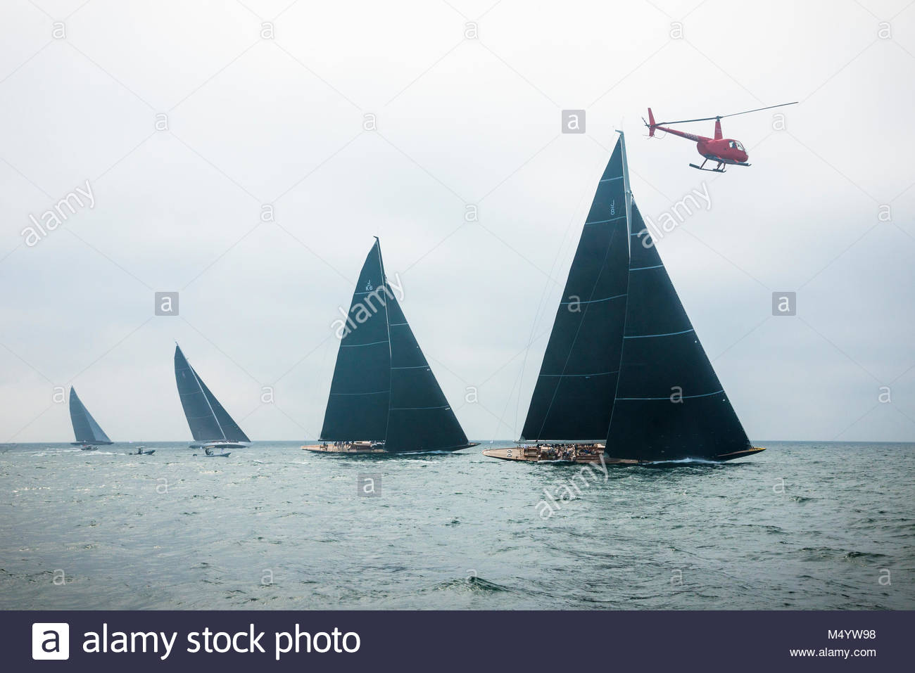 Helicopter covering the first race in the J Class World Championship hosted in Newport, August 2017.  JK-6 Hanuman, Stock Photo